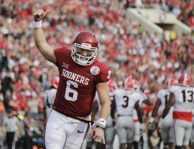 Oklahoma quarterback Baker Mayfield owns the FBS single-season passing efficiency rating record with a 198.9 mark, up from his record-breaking 196.4 clip in 2016. (AP)