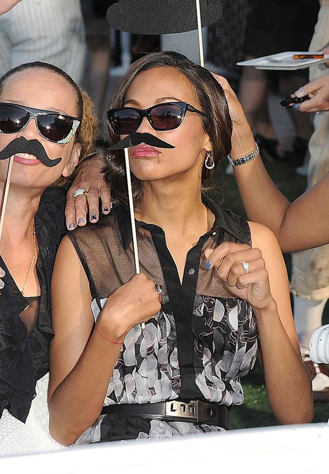 "Guests were instructed to wear their ""most daring '20s and '30s fashions"" to the vintage polo field. Does Zoe Saldana's mustache count?  Jason Merritt/GettyImages.com"