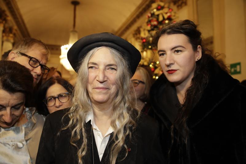"""Musician Patti Smith arrives with her daughter Jesse Smith, right, for the gala premiere of La Scala opera house, in Milan, Italy, Saturday, Dec. 7, 2019. Milan's storied La Scala opens its 2019-2020 season on Saturday with Puccini's """"Tosca,"""" which stars Russian soprano Anna Netrebko as the object of unwanted sexual attention from a powerful authority figure. (AP Photo/Luca Bruno)"""