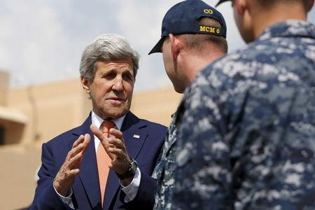 U.S. Secretary of State John Kerry (L) greets officers from the U.S. Navy's Fifth Fleet as he tours the Naval Support Activity Bahrain base in the Gulf, in Manama, Bahrain April 7, 2016. REUTERS/Jonathan Ernst