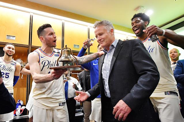 JJ Redick hands the 76ers' celebratory liberty bell back to head coach Brett Brown after their Game 5 victory over the Miami Heat. (Getty)