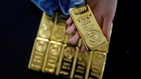 Gold prices trade flat after uncertainty over US-China trade negotiations continues