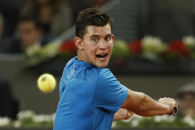 Dominic Thiem from Austria returns the ball during a Madrid Open tennis tournament match against Stanislas Wawrinka from Switzerland, in Madrid, Spain, Tuesday, May 6, 2014. (AP Photo/Andres Kudacki)