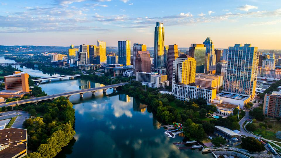 Austin Texas USA sunrise skyline cityscape over Town Lake or Lady Bird Lake with amazing reflection.
