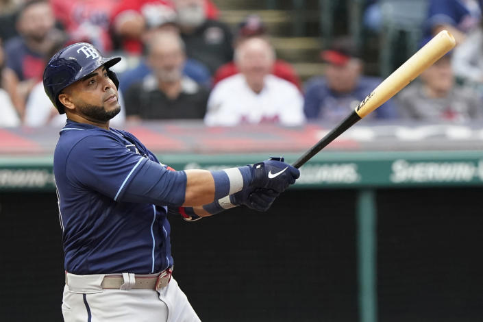 Tampa Bay Rays' Nelson Cruz watches his solo home run in the third inning of the team's baseball game against the Cleveland Indians, Friday, July 23, 2021, in Cleveland. (AP Photo/Tony Dejak)