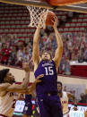 Northwestern center Ryan Young (15) shoots next to Indiana guard Armaan Franklin (2) during the first half of an NCAA college basketball game Wednesday, Dec. 23, 2020, in Bloomington, Ind. (AP Photo/Doug McSchooler)
