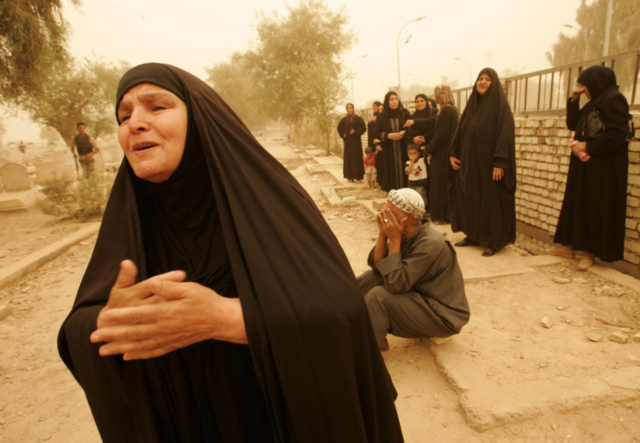 The grandmother (L) and other relatives mourn during a funeral for a neighbourhood patrol member in a dust storm in northern Baghdad September 16, 2008. A member of a neighbourhood patrol was killed and his companion was left wounded after a bomb planted on their car exploded while they were driving on Monday in Adhamiya district, police said    REUTERS/Omar Obeidi (IRAQ)