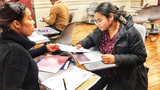 Jasinta De La Cruz, an attorney with the City University of New York's Citizenship Now! program, assists Fairooz Haider with her application to renew her coverage under the DACA program. (Photo: Caitlin Dickson/Yahoo News)