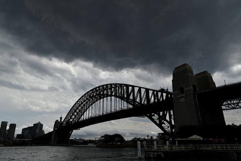 Storm clouds seen over the Sydney Harbour Bridge in Sydney, Monday.