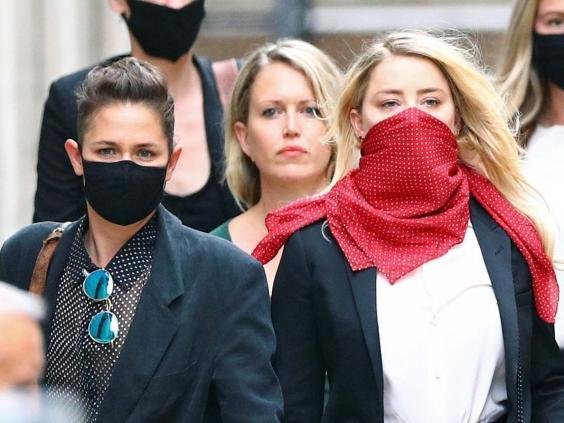Actor Amber Heard leaves the High Court in London on day three of actor Johnny Depp's libel trial against The Sun's publishers and executive editor, 9 July 2020. (REUTERS)