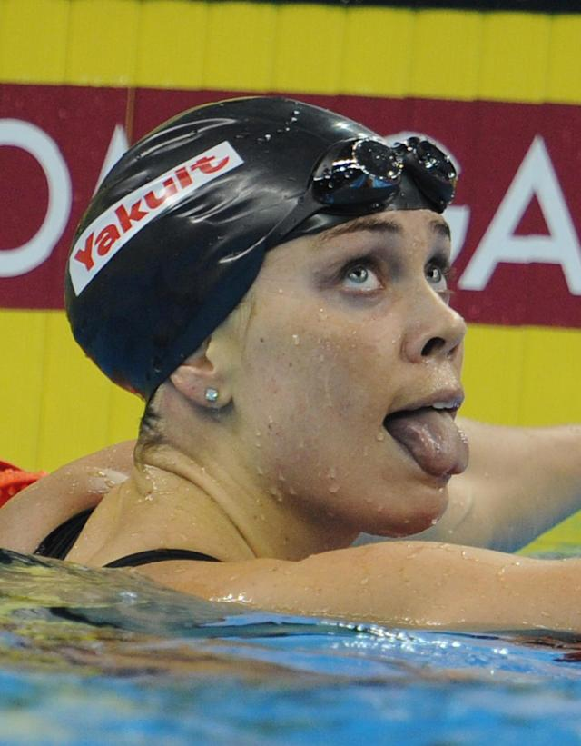 US swimmer Natalie Coughlin sticks her tongue out after she competed in the final of the women's 100-metre backstroke swimming event in the FINA World Championships at the indoor stadium of the Oriental Sports Center in Shanghai on July 26, 2011. She won bronze. AFP PHOTO / PETER PARKS (Photo credit should read PETER PARKS/AFP/Getty Images)