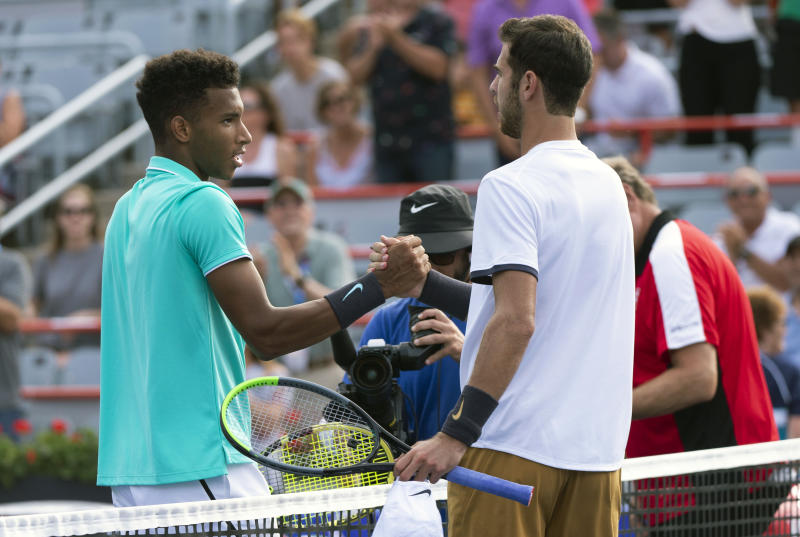 Felix Auger-Aliassime of Canada, left, congratulates Karen Khachanov of Russia on his victory during the Rogers Cup men's tennis tournament Thursday, Aug. 8, 2019, in Montreal. (Paul Chiasson/The Canadian Press via AP)