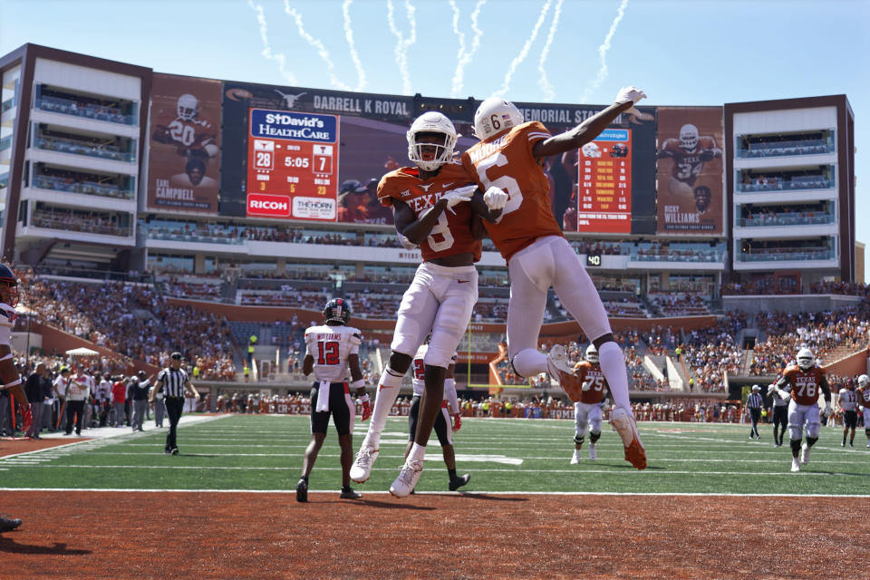 Texas wide receiver Xavier Worthy (8) celebrates his touchdown catch against Texas Tech with Joshua Moore (6) during the first half of an NCAA college football game on Saturday, Sept. 25, 2021, in Austin, Texas. (AP Photo/Chuck Burton)
