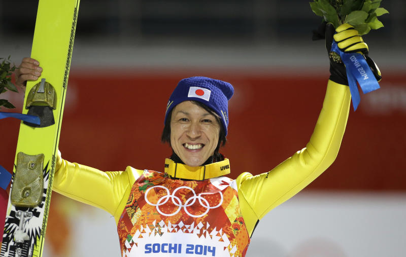Japan's Noriaki Kasai celebrates winning the silver after the ski jumping large hill final at the 2014 Winter Olympics, Saturday, Feb. 15, 2014, in Krasnaya Polyana, Russia. (AP Photo/Gregorio Borgia)