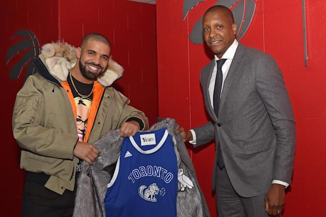 Drake with the president of the Toronto Raptors, Masai Ujiri, in November 2016. (Photo: Ron Turenne/NBAE via Getty Images)
