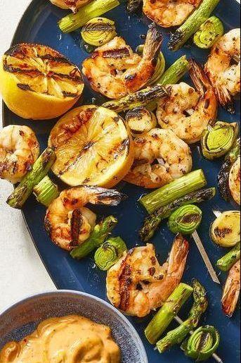 """<p>Because cocktail shrimp are boring. Serve this shrimp and veggie trip with a spicy homemade sauce for a punch of flavor.</p><p><em><a href=""""https://www.goodhousekeeping.com/food-recipes/easy/a27270375/charred-shrimp-leek-and-asparagus-skewers-recipe/"""" rel=""""nofollow noopener"""" target=""""_blank"""" data-ylk=""""slk:Get the recipe for Charred Shrimp, Leek, and Asparagus Skewers »"""" class=""""link rapid-noclick-resp"""">Get the recipe for Charred Shrimp, Leek, and Asparagus Skewers »</a></em></p><p><strong>RELATED: </strong><a href=""""https://www.goodhousekeeping.com/food-recipes/g4327/grilled-shrimp-recipes/"""" rel=""""nofollow noopener"""" target=""""_blank"""" data-ylk=""""slk:20 Quick and Easy Grilled Shrimp Recipes to Try This Summer"""" class=""""link rapid-noclick-resp"""">20 Quick and Easy Grilled Shrimp Recipes to Try This Summer</a><br></p>"""