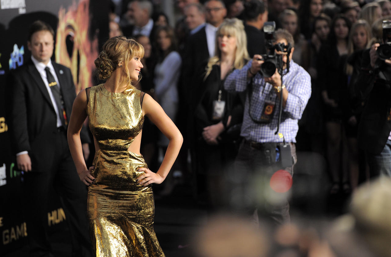 """Jennifer Lawrence arrives at the world premiere of """"The Hunger Games"""" on Monday March 12, 2012 in Los Angeles. (AP Photo/Chris Pizzello)"""