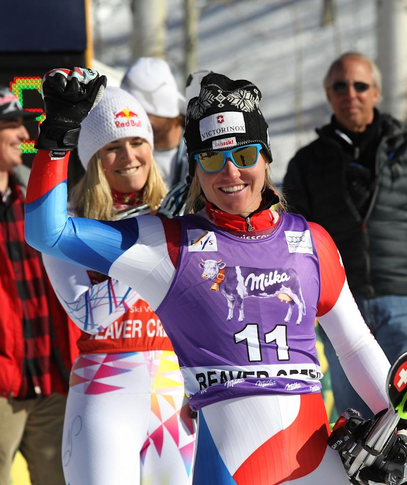 Switzerland's  Fabienne Sutter reacts to her second place finish in the women's World Cup super-G  ski competition in Beaver Creek, Colo. on Wednesday Dec. 7, 2011. The USA's Lindesy Vonn, left won the race. (AP Photo/Alessandro Trovati)