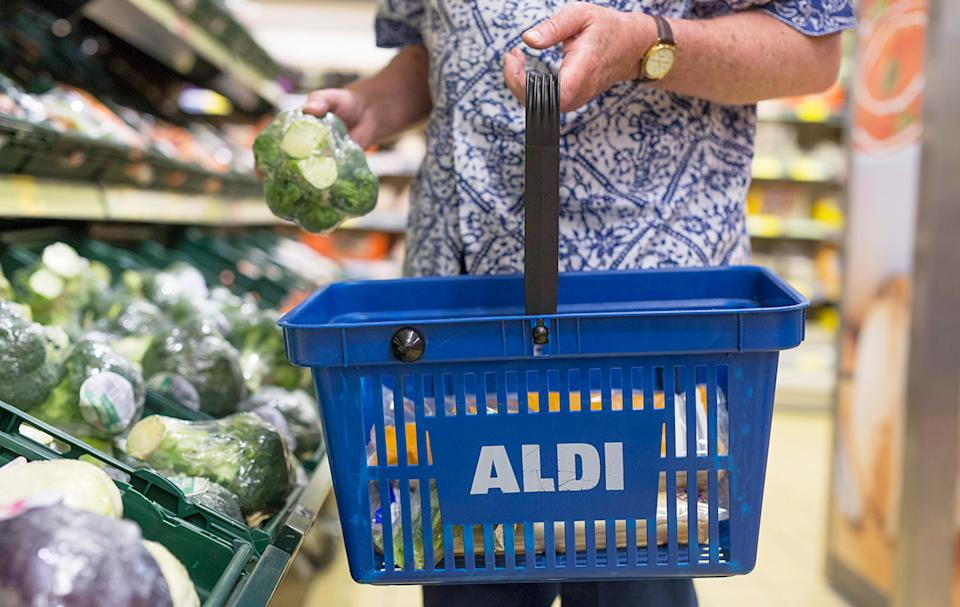 Person shopping at Aldi with a shopping basket
