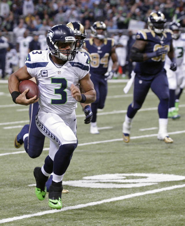 Seattle Seahawks quarterback Russell Wilson (3) rushes against St. Louis Rams defense during the first half of an NFL football game, Monday, Oct. 28, 2013, in St. Louis. (AP Photo/Tom Gannam)