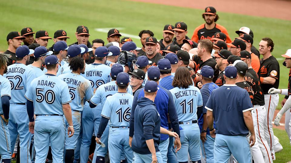 The Baltimore Orioles and Toronto Blue Jays dugouts empty onto the field after Maikel Franco #3 of the Baltimore Orioles was hit by a pitch. (Photo by Greg Fiume/Getty Images)