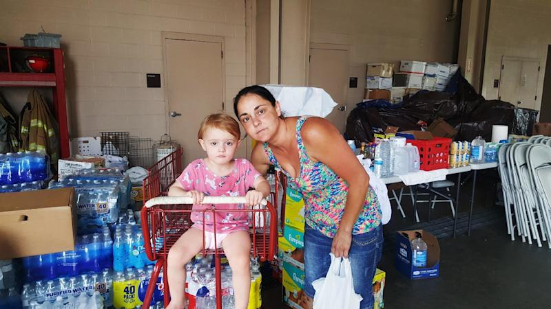 Beth Dougherty and her 2-year-old daughter, Natalee, are staying at the Orange County Emergency Services building in Orange, Texas. Their home was surrounded by floodwaters. (David Lohr/HuffPost)