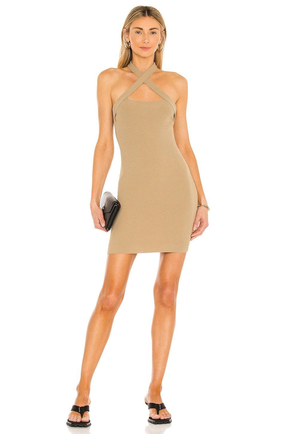 <p>The <span>NBD Yvette Halter Dress in Taupe</span> ($90, originally $128) is such a stunning dress that you can wear to a swanky rooftop bar. The halter neckline adds a sexy touch to the dress. </p>