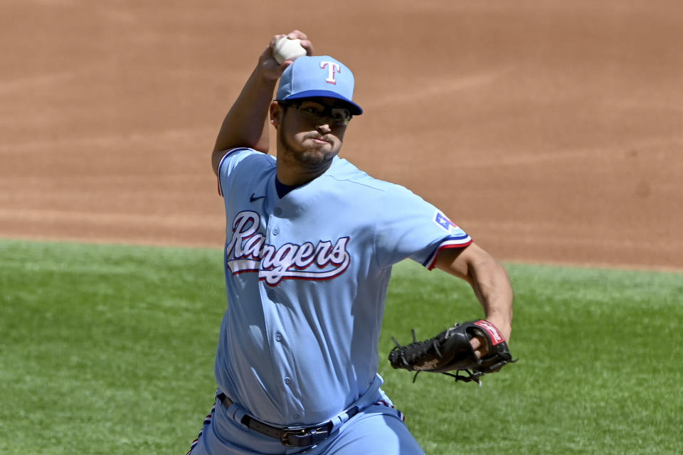 Texas Rangers starting pitcher Dane Dunning throws in the first inning during a baseball game against the Cleveland Indians in Arlington Texas, Sunday, Oct. 3, 2021. (AP Photo/Matt Strasen)