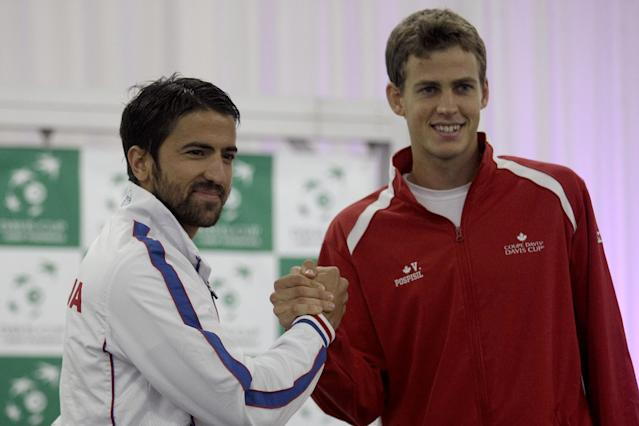 Janko Tipsarevic of Serbia, left, and Vasek Pospisil of Canada pose for a photograph during the Davis Cup semifinals draw ceremony in Belgrade, Serbia, Thursday, Sept. 12, 2013. Serbia and Canada will face each other in the 2013 Davis Cup semifinal that starts on Friday, Sept. 13 in Belgrade. (AP Photo/ Marko Drobnjakovic)