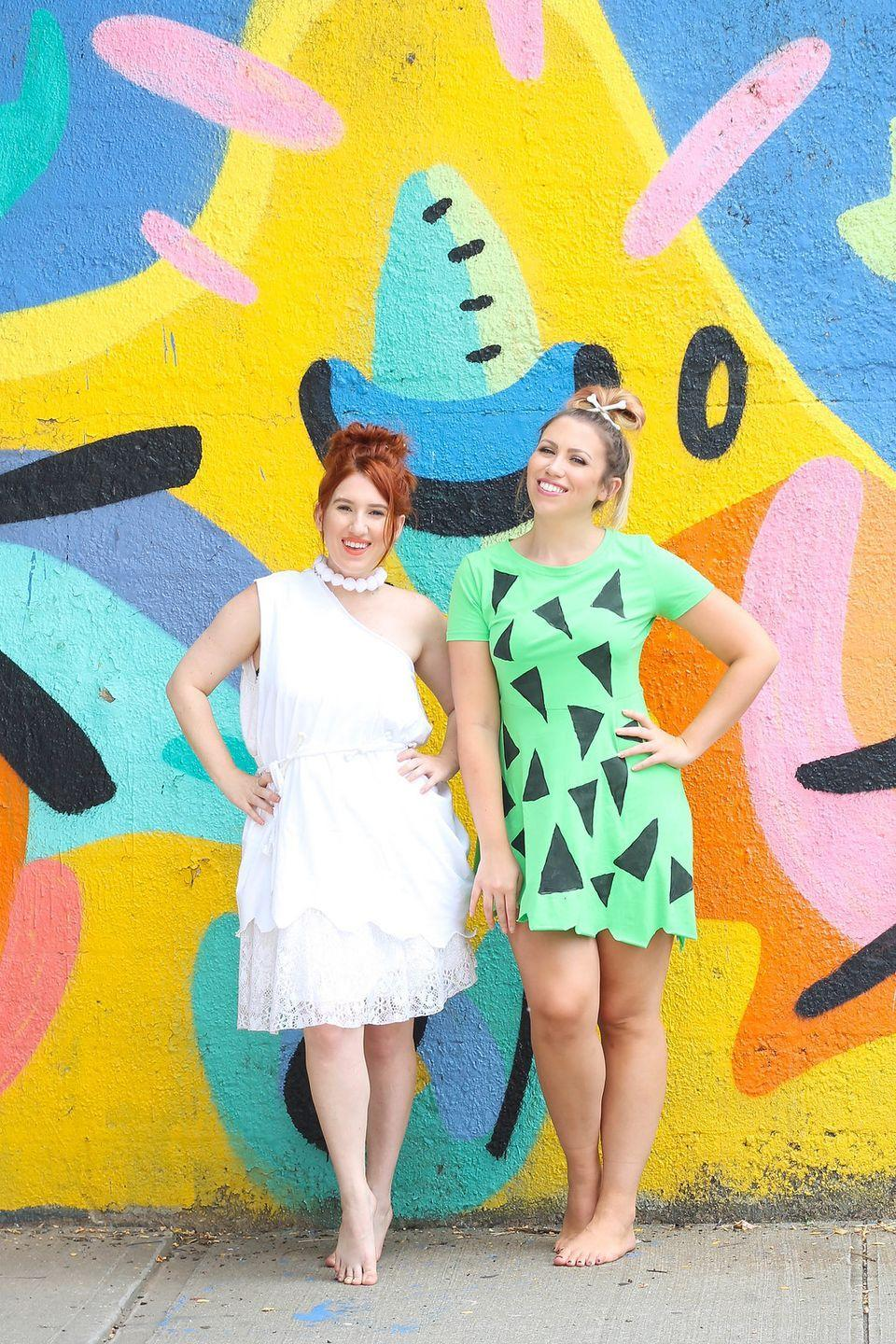 """<p>For a coordinating look, get dressed as Wilma and Pebbles this October 31. Who knew Stone Age outfits could look so cute?</p><p><strong>Get the tutorial at <a href=""""http://livingaftermidnite.com/2017/10/best-friend-halloween-costumes.html"""" rel=""""nofollow noopener"""" target=""""_blank"""" data-ylk=""""slk:Living After Midnite"""" class=""""link rapid-noclick-resp"""">Living After Midnite</a>.</strong></p><p><strong><a class=""""link rapid-noclick-resp"""" href=""""https://www.amazon.com/OMZIN-Womens-T-Shirt-Light-Green/dp/B0746G42CS?tag=syn-yahoo-20&ascsubtag=%5Bartid%7C10050.g.22118522%5Bsrc%7Cyahoo-us"""" rel=""""nofollow noopener"""" target=""""_blank"""" data-ylk=""""slk:SHOP DRESSES"""">SHOP DRESSES</a><br></strong></p>"""