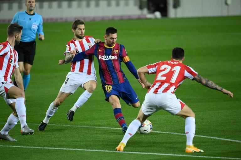 Lionel Messi scored a superb free-kick as Barcelona beat Athletic Bilbao 2-1 on Sunday.