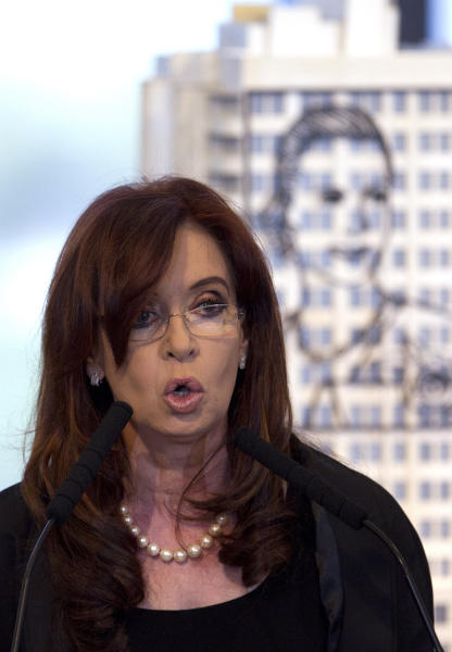 Argentina's President Cristina Fernandez announces a bill to nationalize Spain's controlled oil company YPF, at Government House in Buenos Aires, Argentina, Monday April 16, 2012. Fernandez said in an address to the country that the measure sent to congress on Monday is aimed at recovering the nation's sovereignty over its hydrocarbon resources. Behind Fernandez is a scale model of an iron sculpture of Argentina's former first lady and second wife of late President Juan Peron, Eva Peron. (AP Photo/Natacha Pisarenko)