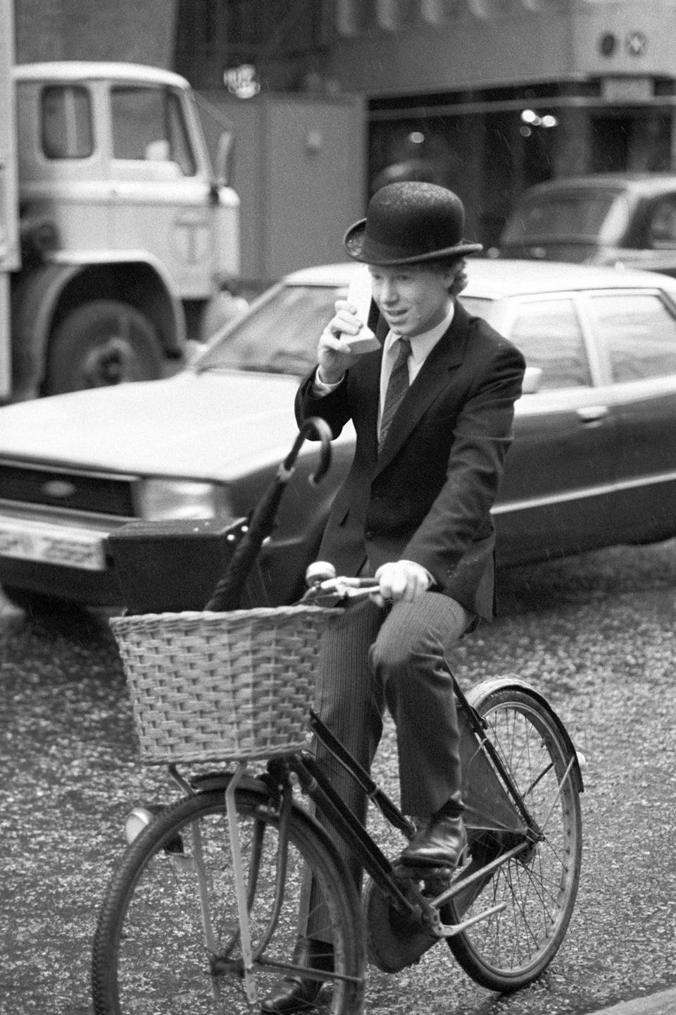 Nicholas Pearce, managing director of Cellular One, speaking directly to the US whilst cycling through London traffic with the first truly portable telephone (PA) (PA Archive)