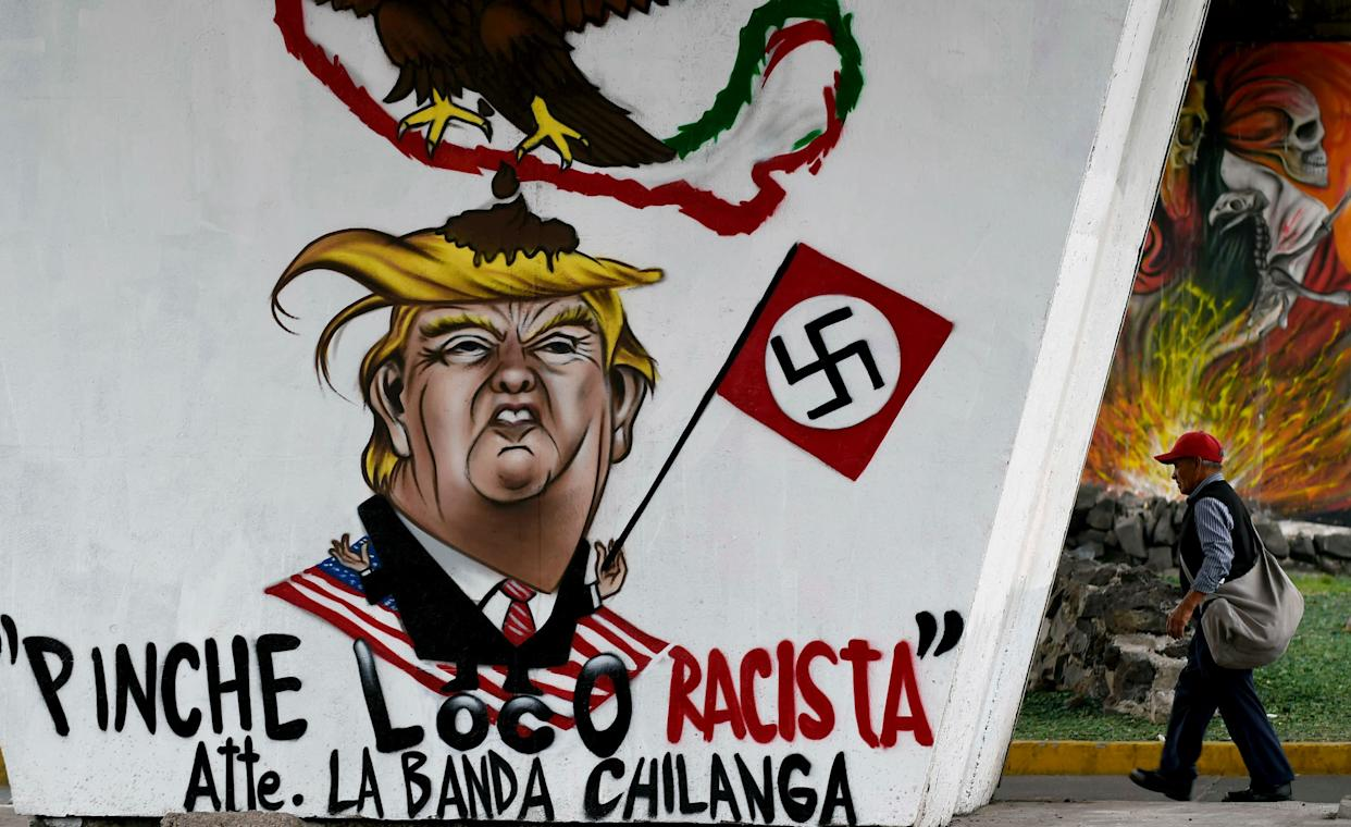 View of a graffiti painted against US President Donald Trump in Mexico City on June 27, 2017.