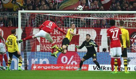 Soccer Football - Bayern Munich v Borussia Dortmund - DFB Pokal Semi Final - Allianz Arena, Munich, Germany - 26/4/17 Bayern Munich's Javi Martinez heads at goal Reuters / Michael Dalder Livepic