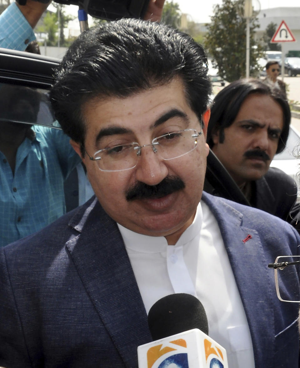 FILE - In this March 12, 2018 file photo, chairman of the Senate Muhammad Sadiq Sanjrani speaks to reporters outside the Parliament in Islamabad, Pakistan. Sanjrani was re-elected as chairman of the Senate, Friday, March 12, 2021. (AP Photo/B.K. Bangash, File)