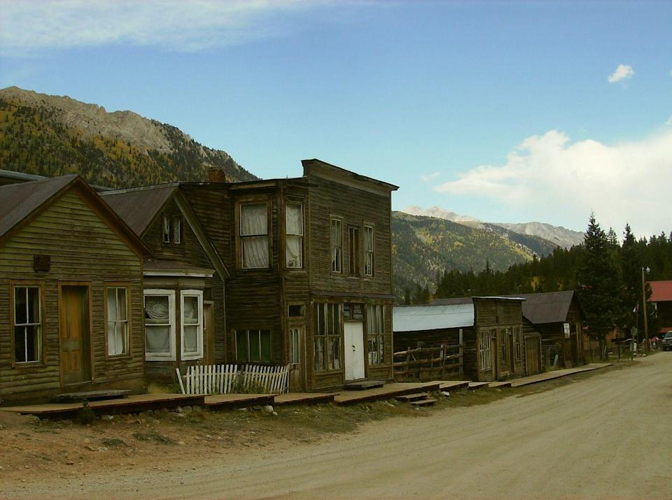 """<p><strong>St. Elmo, CO</strong></p><p>What was once a boisterous, late-1800s gold mining town is now one of Colorado's most well-preserved ghost towns. Mostly abandoned after the nearby railroad closed in the 1920s, a few residents remained. But a devastating fire in 2002 torched several remaining structures. The eerie village has played host to ghost tours for paranormal adventurists and novices alike.<br></p><p>Photo: Flickr/<a href=""""https://www.flickr.com/photos/29531805@N07/24879618722/in/photolist-8pesCD-8phD3d-CUDDFa-Dzg1DN-fLJBz4-GeNNb3-DmSLeM-CXzF6v-DT898t-DSHdff-DZyRNk-D6K68X-Dkrs7P-DsThkv-DaAcsK-DESgnj-D32A39-CXzEuk-D8yMxp-DtKFGb-DCe8kq-Eobvd8-DK3yfZ-DAoDpC-DLNwhr-DEo1N6-DPseXa-DGJ9Fo-DnnXKc-DpVWNN-DP9ojN-Dc9uJf-CFStyD-Dofk2o-CZjYh2-DTVsf2-8p5HeM-DUwxRu-6LYxLm-CKHaN3-zfYvjd-DVnRMf-DxwbJ9-DyXwCX-DG6Hxp-CEbDXa-DCREwL-DwUHGZ-Dxwc59-6LUnsF"""" rel=""""nofollow noopener"""" target=""""_blank"""" data-ylk=""""slk:jaygannett"""" class=""""link rapid-noclick-resp"""">jaygannett</a></p>"""