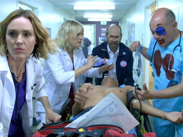 "Erinn Hayes, Malin Akerman, Brian Huskey, and Rob Corddry all costar on ""Medical Police."""