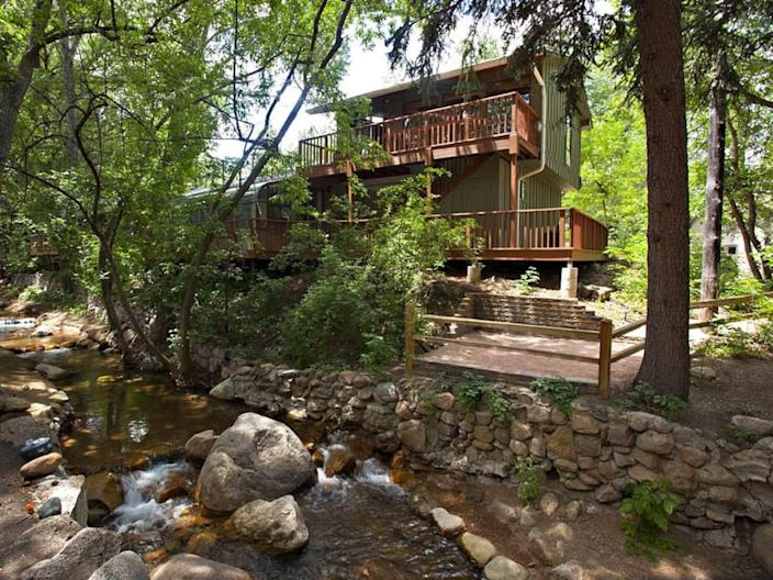 """<h2><a href=""""http://airbnb.pvxt.net/Gx09B"""" rel=""""nofollow noopener"""" target=""""_blank"""" data-ylk=""""slk:Romantic Retreat On Creek"""" class=""""link rapid-noclick-resp"""">Romantic Retreat On Creek</a></h2><br>""""Studio style hidden getaway overlooking Cheyenne Creek with a huge kitchen, romantic wood-burning stove, sleeper sofa, TV, and queen bed! Deer come down every day to say hello! Fall asleep and wake up to the sounds of Cheyenne Creek right outside your window and front deck. This hideaway is located on the upper level, all guests must be able to climb a short set of stairs up one story."""" <br><br><strong>Location:</strong> Colorado Springs, Colorado<br><strong>Sleeps:</strong> 4<br><strong>Price Per Night:</strong> $45"""