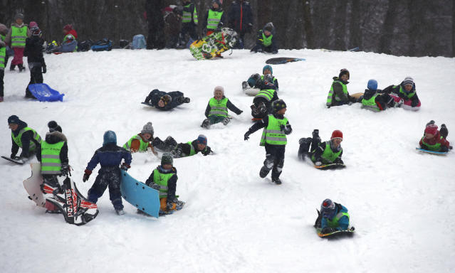 Children enjoy the snow covered slopes after overnight cold weather brought snow to the region, in Oslo, Norway, Wednesday Jan. 16, 2019. (Erik Johansen / NTB scanpix via AP)