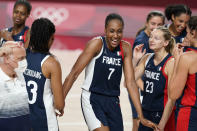 France's Sandrine Gruda (7) celebrates with teammates at the end of a women's basketball quarterfinal round game against Spain at the 2020 Summer Olympics, Wednesday, Aug. 4, 2021, in Saitama, Japan. (AP Photo/Charlie Neibergall)