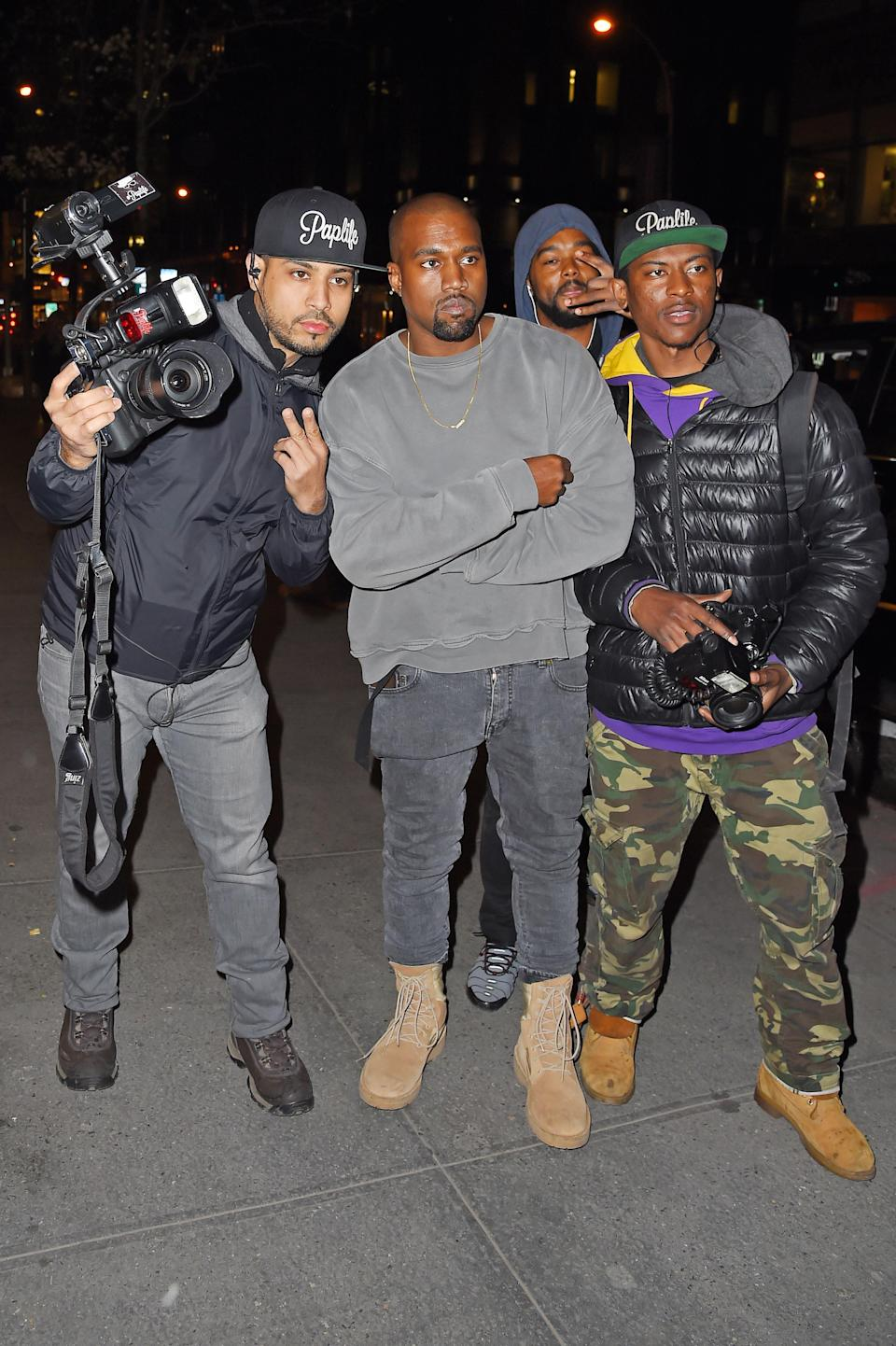 In 2015, Kanye West couldn't find his car in New York City, so these paps were kind enough to help him — and he said thank you with a photo op. (Photo: Getty Images)