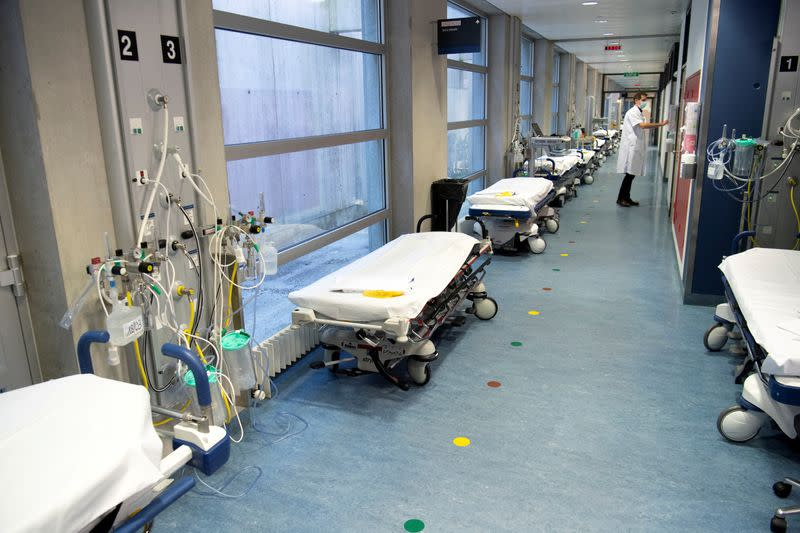 FILE PHOTO: A doctor stands in a corridor lined with hospital beds at the CHUV in Lausanne
