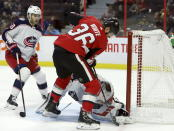 Columbus Blue Jackets goaltender Joonas Korpisalo (70) puts the stop on Ottawa Senators center Colin White (36) as Columbus Blue Jackets center Alexander Wennberg (10) looks on during the second period of an NHL hockey game in Ottawa, Saturday, Dec. 14, 2019. (Fred Chartrand/The Canadian Press via AP)