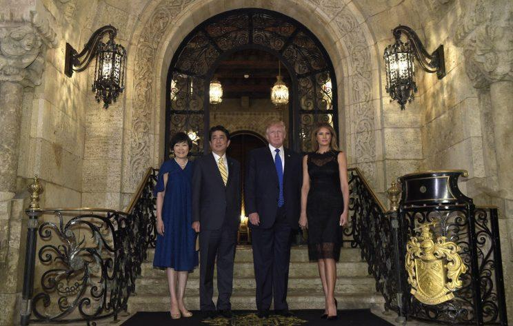 President Donald Trump, and Melania Trump, right, stop to pose for a photo with Japanese Prime Minister Shinzo Abe, second from left, and his wife Akie Abe, left, before they have dinner at Mar-a-Lago in Palm Beach, Fla., Saturday, Feb. 11, 2017. (Photo: AP /Susan Walsh)