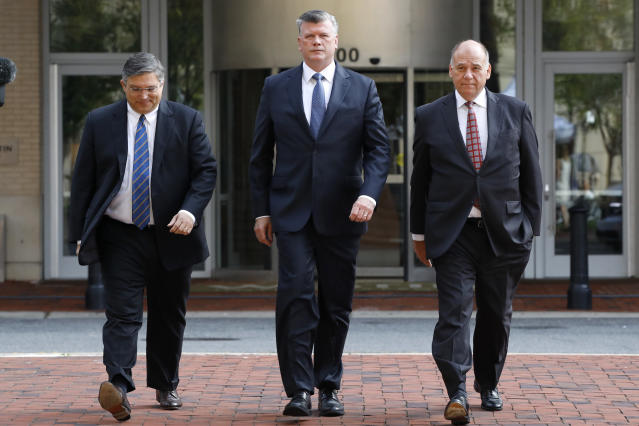 <p>Richard Westling, left, Kevin Downing, and Thomas Zehnle, with the defense team for Paul Manafort, arrive at federal court for the second day of jury deliberations in the trial of the former Trump campaign chairman, in Alexandria, Va., Friday, Aug. 17, 2018. (Photo: Jacquelyn Martin/AP) </p>