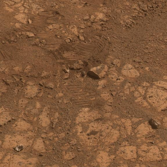 """This image from the panoramic camera on NASA's Mars Exploration Rover Opportunity shows where a rock called """"Pinnacle Island"""" had been before it appeared in front of the rover in early January 2014. This image was taken on Feb. 4, 2014."""