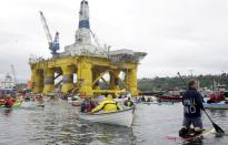 FILE PHOTO: Activists protest the Shell Oil Company's drilling rig Polar Pioneer which is parked at Terminal 5 at the Port of Seattle, Washington