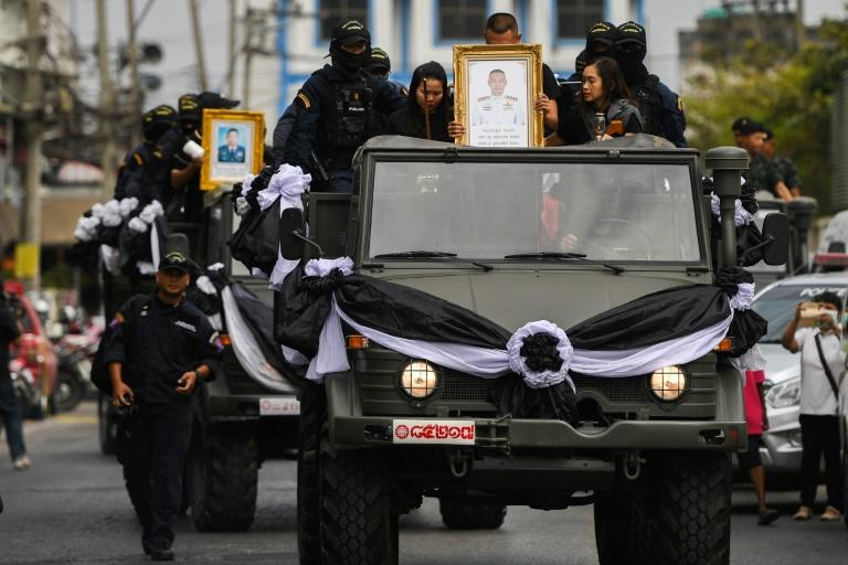 The coffins of SWAT team members Trakool Tha-arsa and Petcharat Kamjadpai, who were killed in a mass shooting, are taken to an air base in the Thai northeastern city of Nakhon Ratchasima
