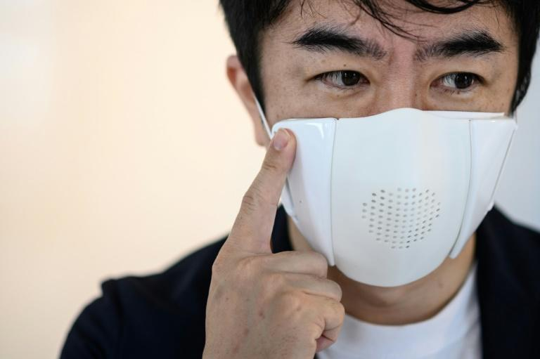 Taisuke Ono's start-up Donut Robotics has created a mask that helps users adhere to social distancing and also acts as a translator